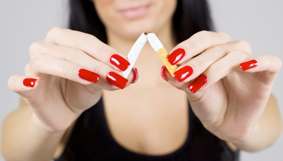 Woman hands breaking cigarette.